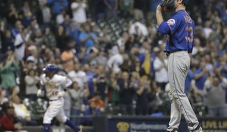 New York Mets starting pitcher Matt Harvey reacts as Milwaukee Brewers' Eric Sogard rounds the bases after hitting a two-run home run during the sixth inning of a baseball game Friday, May 12, 2017, in Milwaukee. (AP Photo/Morry Gash)