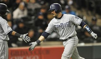 San Diego Padres' Austin Hedges right, celebrates with teammate Erick Ayabar left, at home plate after hitting a solo home run during the fifth inning of an interleague baseball game against the Chicago White Sox, Friday, May 12, 2017, in Chicago. (AP Photo/Paul Beaty)