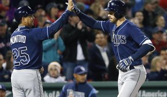 Tampa Bay Rays' Evan Longoria, right, celebrates his two-run home run with third base coach Charlie Montoyo (25) during the fifth inning of a baseball game against the Boston Red Sox, Friday, May 12, 2017, in Boston. (AP Photo/Michael Dwyer)