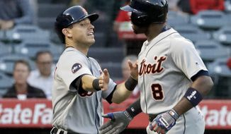 Detroit Tigers' Justin Upton, right, celebrates his three-run home run with Ian Kinsler, against the Los Angeles Angels during the first inning of a baseball game in Anaheim, Calif., Thursday, May 11, 2017. (AP Photo/Chris Carlson)
