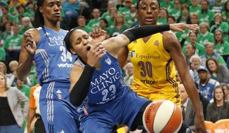 FILE - In this Oct. 20, 2016, file photo, Minnesota Lynx's Maya Moore, center, loses the ball in a rebound attempt with Los Angeles Sparks' Nneka Ogwumike, right, in the first quarter during Game 5 of the WNBA basketball finals, in Minneapolis. Of all the losses Lindsay Whalen has suffered in her career, Game 5 of the WNBA Finals last fall was easily the toughest. Maya Moore, Seimone Augustus, Cheryl Reeve, all agreed. (AP Photo/Jim Mone, File)