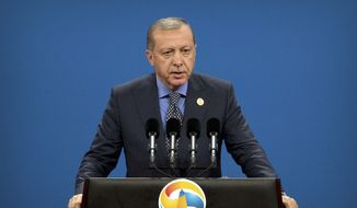 """Turkey's President Recep Tayyip Erdogan speaks during the opening ceremony of the Belt and Road Forum at the China National Convention Center in Beijing, Sunday, May 14, 2017. Erdogan is in China to attend the two-day """"Belt and Road"""" conference hosted by Chinese President Xi Jinping in Beijing that brought together leaders from 29 countries. (AP Photo/Mark Schiefelbein, Pool)"""