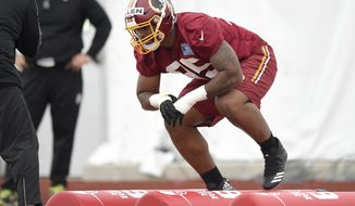 Washington Redskins defensive lineman Jonathan Allen runs through a drill during NFL football rookie minicamp, Saturday, May 13, 2017, in Ashburn, Va. (AP Photo/Nick Wass)
