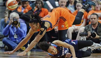 Connecticut Sun's Alyssa Thomas goes sprawling as she and Atlanta Dream's Brianna Kiesel (3) chase the ball during the first half of a WNBA basketball game Saturday, May 13, 2017, in Uncasville, Conn. (Sean D. Elliot/The Day via AP)