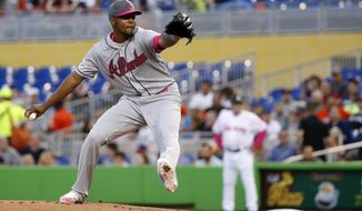 Atlanta Braves' Julio Teheran delivers a pitch during the first inning of a baseball game against the Miami Marlins, Saturday, May 13, 2017, in Miami. (AP Photo/Wilfredo Lee)