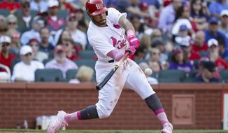 St. Louis Cardinals' Tommy Pham hits an RBI double to drive in Greg Garcia during the sixth inning of a baseball game against the Chicago Cubs, Saturday, May 13, 2017, in St. Louis. (AP Photo/Tim Spyers)