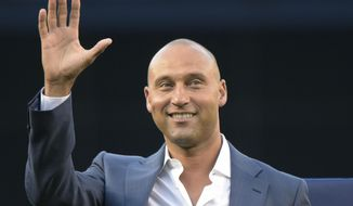 FILE- In this May 24, 2015, file photo, Derek Jeter waves to fans as he is introduced, at the dedication of a plaque for Bernie Williams in Monument Park, before the New York Yankees' baseball game against the Texas Rangers at Yankee Stadium in New York. (AP Photo/Bill Kostroun, File)