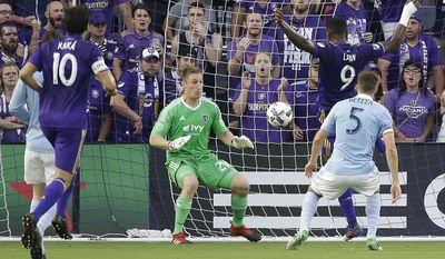 Orlando City's Cyle Larin (9) scores a goal past Sporting Kansas City goalkeeper Tim Melia (29) as he gets around Matt Besler (5) while Orlando City's Kaka (10) watches during the first half of an MLS soccer match, Saturday, May 13, 2017, in Orlando, Fla. (AP Photo/John Raoux)