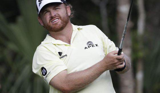J.B. Holmes watches his shot from the 15th tee during the third round of The Players Championship golf tournament Saturday, May 13, 2017, in Ponte Vedra Beach, Fla. (AP Photo/Chris O'Meara)