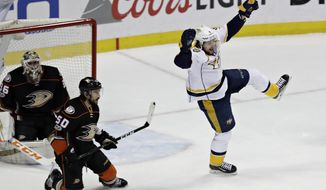 Nashville Predators' Filip Forsberg, right, celebrates after scoring against Anaheim Ducks' Antoine Vermette, center, and goalie John Gibson during the first period of Game 1 in the NHL hockey Stanley Cup Western Conference finals, Friday, May 12, 2017, in Anaheim, Calif. (AP Photo/Chris Carlson)