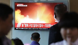 "People watch a TV news program showing a file image of a missile launch conducted by North Korea, at the Seoul Railway Station in Seoul, South Korea, Sunday, May 14, 2017. North Korea on Sunday test-launched a ballistic missile that landed in the Sea of Japan, the South Korean, Japanese and U.S. militaries said. The launch is a direct challenge to the new South Korean president elected four days ago and comes as U.S., Japanese and European navies gather for joint war games in the Pacific. The signs read: ""A missile was fired from near Kusong in North Phyongan province."" (AP Photo/Ahn Young-joon)"