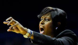 Georgetown head coach Natasha Adair against Xavier during an NCAA college basketball game in the first round of the Big East Conference tournament in Rosemont, Ill., on Saturday, March 7, 2015. (AP Photo/Matt Marton) **FILE**