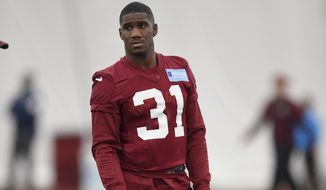 Washington Redskins defensive back Fabian Moreau (31) holds a football during an NFL football rookie minicamp, Saturday, May 13, 2017, in Ashburn, Va. (AP Photo/Nick Wass)