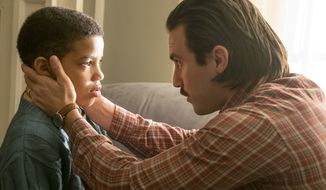 "In this image released by NBC, Lonnie Chavis, left, and Milo Ventimiglia appear in a scene from ""This Is Us."" NBC is reviving its ""must-see TV"" Thursday franchise this fall with the revival of ""Will & Grace,"" and by moving its heartwarming hit ""This is Us"" to the same night. The network announced its schedule Sunday, May 14, 2017, kicking off the annual week where broadcasters outline next season's plans to advertisers. (Ron Batzdorff/NBC via AP)"