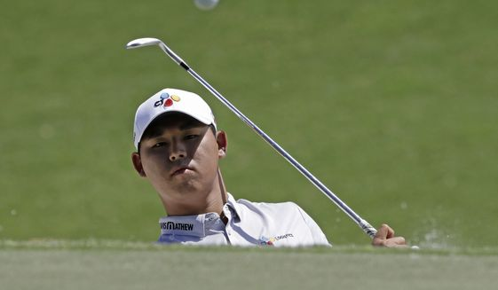 Si Woo Kim, of South Korea, chips onto the third green during the final round of The Players Championship golf tournament Sunday, May 14, 2017, in Ponte Vedra Beach, Fla. (AP Photo/Chris O'Meara)