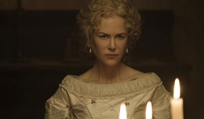 """This image released by Focus Features shows Nicole Kidman in a scene from """"The Beguiled."""" The film, directed by Sofia Coppola and opens June 23, will be shown at the 70th Cannes Film Festival. (Ben Rothstein/Focus Features via AP)"""