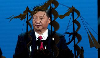 Chinese President Xi Jinping speaking at the opening of the Belt and Road Forum is displayed on a big screen near a decoration depicting Chinese Admiral Zheng He who commanded expeditionary voyages across Asia and East Africa in the 15th century in Beijing, China, Sunday, May 14, 2017. China will seek to burnish President Xi Jinping's stature as a world-class statesman at the international gathering centered on his signature foreign policy effort that envisions a future world order in which all roads lead to Beijing. (AP Photo/Ng Han Guan)