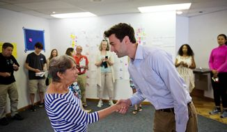 "Volunteer Harriet Zoller, left, greets Jon Ossoff, a 30-year-old Democrat running for Congress in Georgia's traditionally conservative 6th Congressional District at his campaign office in Sandy Springs, Ga., Thursday, May 11, 2017. The last time Zoller volunteered for a political campaign, she was too young to vote for the Massachusetts senator running for president. ""I was a Kennedy girl,"" she says, smiling back to 1960. ""I still have the letter."" (AP Photo/David Goldman)"