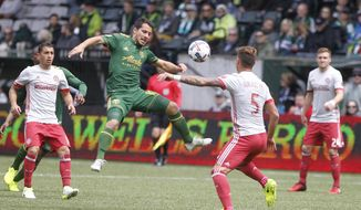 Portland's Sebastian Blanco, center, tries to corral the ball as Atlanata's Leandro Gonz'lez Pirez (5) defends as the Portland Timbers hosted Atlanta United FC in a MLS match at in Portland, Ore., Sunday, May 14, 2017.  (Sean Meagher/The Oregonian via AP)