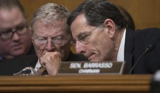 FILE - In this Jan. 18, 2017 file photo, Senate Environment and Public Works Committee Chairman Sen. John Barrasso, R-Wyo., right, confers with Sen. James Inhofe, R-Okla. on Capitol Hill in Washington, during the committee's confirmation hearing for Environmental Protection Agency Administrator-designate, Oklahoma Attorney General Scott Pruitt.  Republicans anxious to show they've done something point to the reversal of more than a dozen Obama-era regulation on guns, the internet and the environment.  (AP Photo/J. Scott Applewhite)