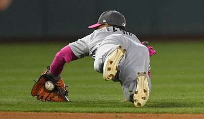 Detroit Tigers shortstop Jose Iglesias dives for a ground ball hit for a single by Los Angeles Angels' Yunel Escobar during the fifth inning of a baseball game, Saturday, May 13, 2017, in Anaheim, Calif. (AP Photo/Mark J. Terrill)