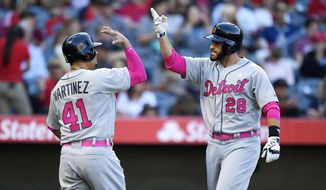 Detroit Tigers' Victor Martinez, left, congratulates J.D. Martinez after J.D. Martinez hit a two-run home run during the second inning of a baseball game against the Los Angeles Angels, Saturday, May 13, 2017, in Anaheim, Calif. (AP Photo/Mark J. Terrill)