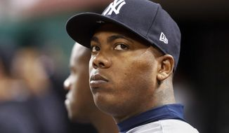 FILE - In this Monday, May 8, 2017, file photo, New York Yankees relief pitcher Aroldis Chapman sits in the dugout in the ninth inning of a baseball game against the Cincinnati Reds in Cincinnati. The New York Yankees have placed closer Chapman on the 10-day disabled list with rotator cuff inflammation in his left shoulder. The Yankees announced the move Sunday, May 14, before the first game of a day-night doubleheader against the Houston Astros. (AP Photo/John Minchillo, File)