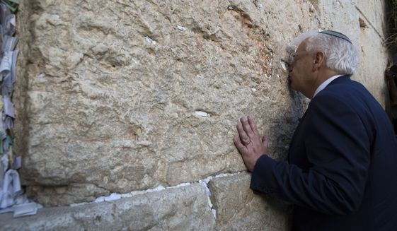U.S. Ambassador to Israel David Friedman kisses the stones of the Western Wall, the holiest site where Jews can pray in Jerusalem's Old City, Monday, May 15, 2017. (AP Photo/Sebastian Scheiner)