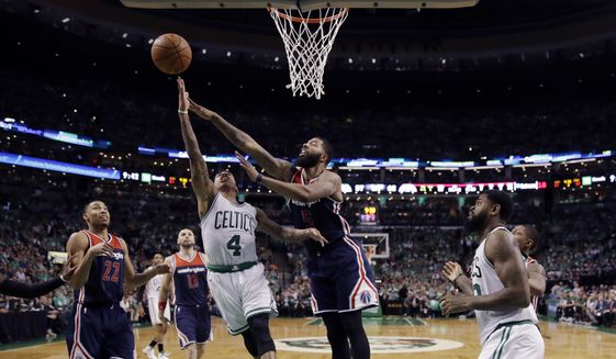 Boston Celtics guard Isaiah Thomas (4) drives against Washington Wizards forward Markieff Morris (5) during the fourth quarter of Game 7 of a second-round NBA basketball playoff series, Monday, May 15, 2017, in Boston. (AP Photo/Charles Krupa)