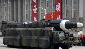 "ADDS DETAIL ABOUT MISSILE - In this April 15, 2017, file photo, an unidentified missile that analysts believe could be the North Korean Hwasong-12 is paraded across Kim Il Sung Square in Pyongyang.  The country's official Korean Central News Agency said the missile fired Sunday, May 14, 2017, was a Hwasong-12 ""capable of carrying a large-size heavy nuclear warhead."" The Hwasong-10 appeared in the military parade in Pyongyang on April 15, 2017, followed by this unidentified missile.  (AP Photo/Wong Maye-E, File)"