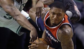 Washington Wizards guard Bradley Beal, right, goes down with the ball as Boston Celtics guard Marcus Smart defends during the second quarter of Game 7 of a second-round NBA basketball playoff series, Monday, May 15, 2017, in Boston. (AP Photo/Charles Krupa)