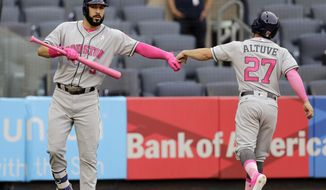 Houston Astros' Jose Altuve, right, celebrates with Marwin Gonzalez after scoring a run during the third inning of a baseball game against the New York Yankees, Sunday, May 14, 2017, in New York. (AP Photo/Seth Wenig)