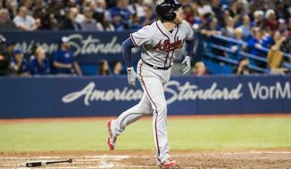 Atlanta Braves' Freddie Freeman hits a three-run home run against the Toronto Blue Jays during the sixth inning of a  baseball game in Toronto, Monday May 15, 2017. (Mark Blinch/The Canadian Press via AP)