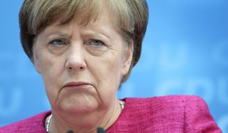 German Chancellor and chairwoman of the German Christian Democratic Party (CDU) Angela Merkel attends a press conference at the party's headquarters in Berlin, Germany, Monday, May 15, 2017, one day after the election in the German state of North Rhine-Westphalia. (AP Photo/Michael Sohn)