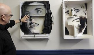 """In this Monday, May 8, 2017 photo artist Richard Neal, of Centerville, Mass., left, talks about his multi-media constructions called """"Jackie,"""" center, and """"Jack,"""" right, at the John F. Kennedy Hyannis Museum in Hyannis, Mass. The art objects were created from household objects and construction materials removed during a recent renovation of John F. Kennedy's summer home. The items removed from the house were preserved and offered to Cape Cod artists who in turn fashioned them into artwork. (AP Photo/Steven Senne)"""