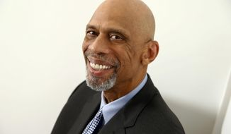 """Retired NBA basketball player and author Kareem Abdul-Jabbar poses for a portrait on Monday, May 15, 2017 in New York to promote his book, """"Coach Wooden and Me: Our 50-Year Friendship On and Off the Court."""" (Photo by Brian Ach/Invision/AP)"""