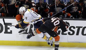 Nashville Predators' Mattias Ekholm (14) collides with Anaheim Ducks' Jared Boll (40) during the second period of Game 2 of the Western Conference final in the NHL hockey Stanley Cup playoffs, Sunday, May 14, 2017, in Anaheim, Calif. (AP Photo/Chris Carlson)