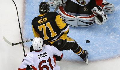 Ottawa Senators goalie Craig Anderson (41) stops a shot by Pittsburgh Penguins' Evgeni Malkin (71) during the first period of Game 2 of the Eastern Conference final with Mark Stone (61) defending in the NHL Stanley Cup hockey playoffs in Pittsburgh, Monday, May 15, 2017.(AP Photo/Gene J. Puskar)