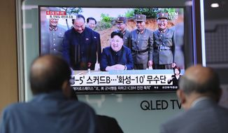 "People watch a TV news program showing an image of North Korean leader Kim Jong Un, published in the country's Rodong Sinmun newspaper, at Seoul Railway station in Seoul, South Korea, Monday, May 15, 2017. North Korea said Monday the missile it launched over the weekend was a new type of ""medium long-range"" ballistic rocket that can carry a heavy nuclear warhead. A jubilant leader Kim Jong Un promised more nuclear and missile tests and warned that North Korean weapons could strike the U.S. mainland and Pacific holdings. (AP Photo/Lee Jin-man)"