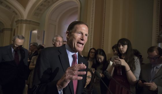 Sen. Richard Blumenthal, D-Conn., and other Democrats respond to questions from reporters about President Donald Trump reportedly sharing classified information with two Russian diplomats during a meeting in the Oval Office, Tuesday, May 16, 2017, on Capitol Hill in Washington. (AP Photo/J. Scott Applewhite)