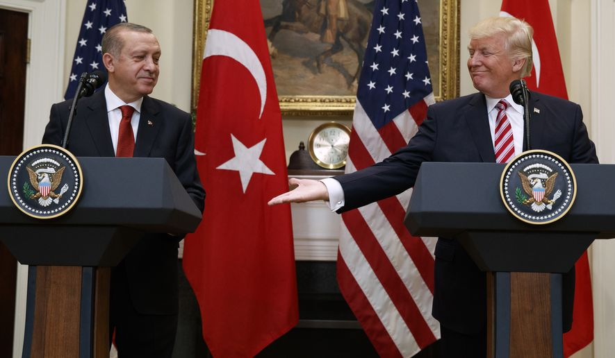 President Donald Trump reaches out to shake hands with Turkish President Recep Tayyip Erdogan in the Roosevelt Room of the White House, Tuesday, May 16, 2017, in Washington. (AP Photo/Evan Vucci)