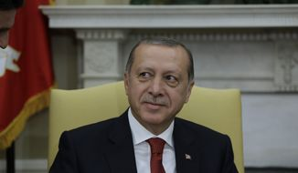 Turkish President Recep Tayyip Erdogan listens during his meeting with President Donald Trump in the Oval Office of the White House in Washington, Tuesday, May 16, 2017. (AP Photo/Evan Vucci)