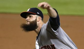 Houston Astros' Dallas Keuchel delivers a pitch during the first inning of a baseball game against the Miami Marlins, Tuesday, May 16, 2017, in Miami. (AP Photo/Wilfredo Lee)