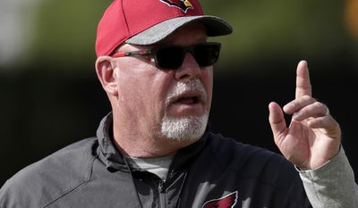 Arizona Cardinals NFL football head coach Bruce Arians signals his players during a voluntary team workout, Tuesday, May 16, 2017, in Tempe, Ariz. (AP Photo/Matt York)