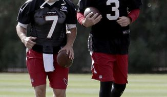 Arizona Cardinals NFL football quarterback Carson Palmer (3) and Blaine Gabbert (7) run drills during a voluntary team workout, Tuesday, May 16, 2017, in Tempe, Ariz. The Arizona Cardinals have five quarterbacks on their roster. One big reason is a concerted effort to prevent Carson Palmer from doing much of anything in the offseason to preserve the arm strength of the 37-year-old quarterback. (AP Photo/Matt York)