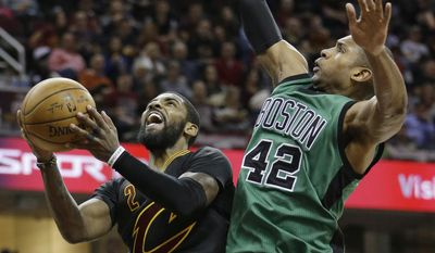 FILE - In this Dec. 29, 2016, file photo, Cleveland Cavaliers' Kyrie Irving, left, drives to the basket against Boston Celtics' Al Horford, from the Dominican Republic, in the second half of an NBA basketball game,in Cleveland. The defending champion Cavaliers have been awaiting an Eastern Conference finals opponent since completing a sweep of the Toronto Raptors. After what will be a 10-day wait, LeBron James and company will travel to face the top-seeded Celtics in Game 1 on Wednesday night, May 17. (AP Photo/Tony Dejak, File)