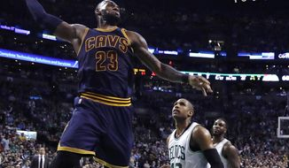 FILE - In this March 1, 2017, file photo, Cleveland Cavaliers forward LeBron James (23) lines up a dunk against Boston Celtics center Al Horford (42) during the third quarter of an NBA basketball game in Boston. The defending champion Cavaliers have been awaiting an Eastern Conference finals opponent since completing a sweep of the Toronto Raptors. After what will be a 10-day wait, LeBron James and company will travel to face the top-seeded Celtics in Game 1 on Wednesday night, May 17. (AP Photo/Charles Krupa, FIle)