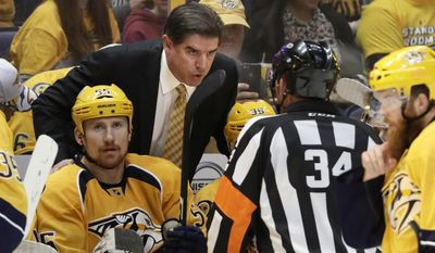 Nashville Predators head coach Peter Laviolette talks to referee Brad Meier (34) during the second period in Game 3 of the Western Conference final against the Anaheim Ducks in the NHL hockey Stanley Cup playoffs Tuesday, May 16, 2017, in Nashville, Tenn. (AP Photo/Mark Humphrey)