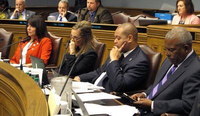 Lawmakers on the House Ways and Means Committee sit and listen during debate on a bill that would raise Louisiana's gasoline tax, on Tuesday, May 16, 2017, in Baton Rouge, La. (AP Photo/Melinda Deslatte)