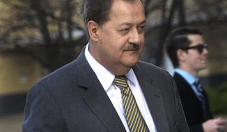 FILE - In a Wednesday, April 6, 2016, file photo, former Massey CEO Don Blankenship is escorted by Homeland Security officers from the Robert C. Byrd U.S. Courthouse in Charleston, W. Va. Blankenship has asked President Donald Trump to resist attempts in Congress to enhance criminal penalties for coal executives who violate mine safety and health standards.Blankenship, who recently was freed from federal prison, also asked the president in a letter Tuesday, May 16, 2017, to re-examine a federal investigation into the nation's worst coal mining disaster in four decades. (F. Brian Ferguson/Charleston Gazette-Mail via AP, File)